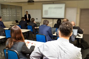 business people group at meeting seminar presentation